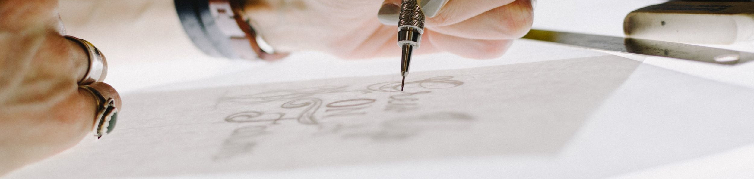 Close up of woman's hands doing a fine drawing.